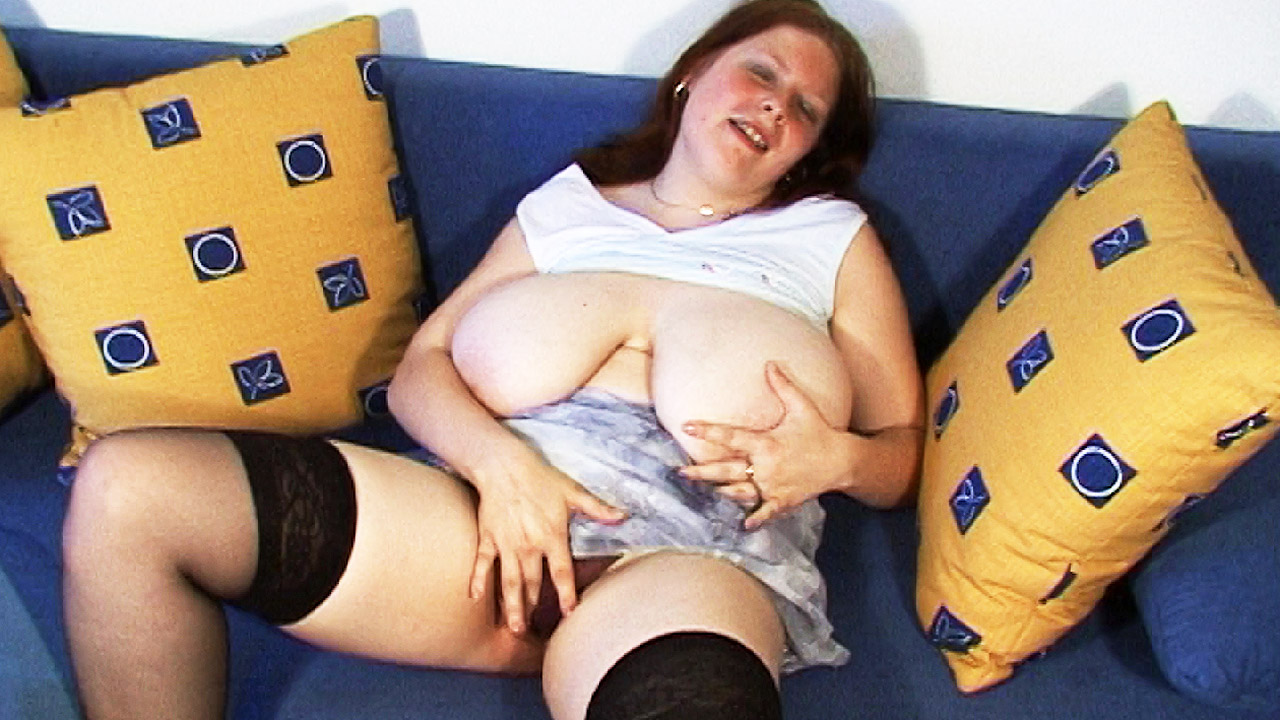 Big Babe In Stockings Fingers Her Pussy