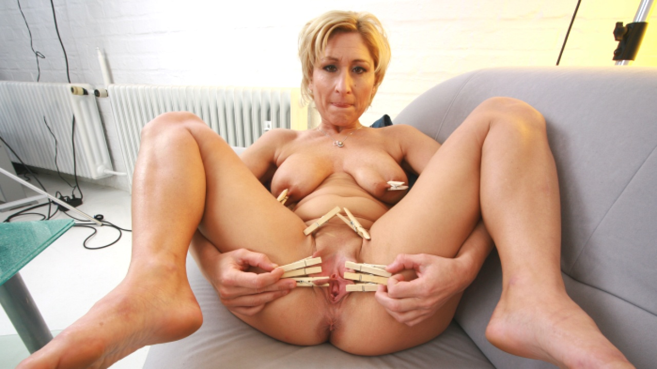 Blonde Slut Gets Covered In Clothes Pegs