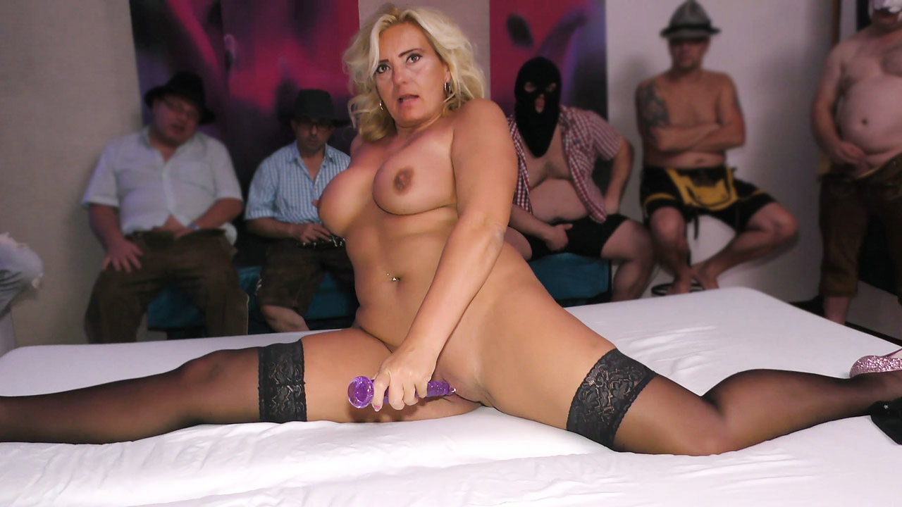 Busty Blonde Soaked With Cum In Bukkake Gangbang