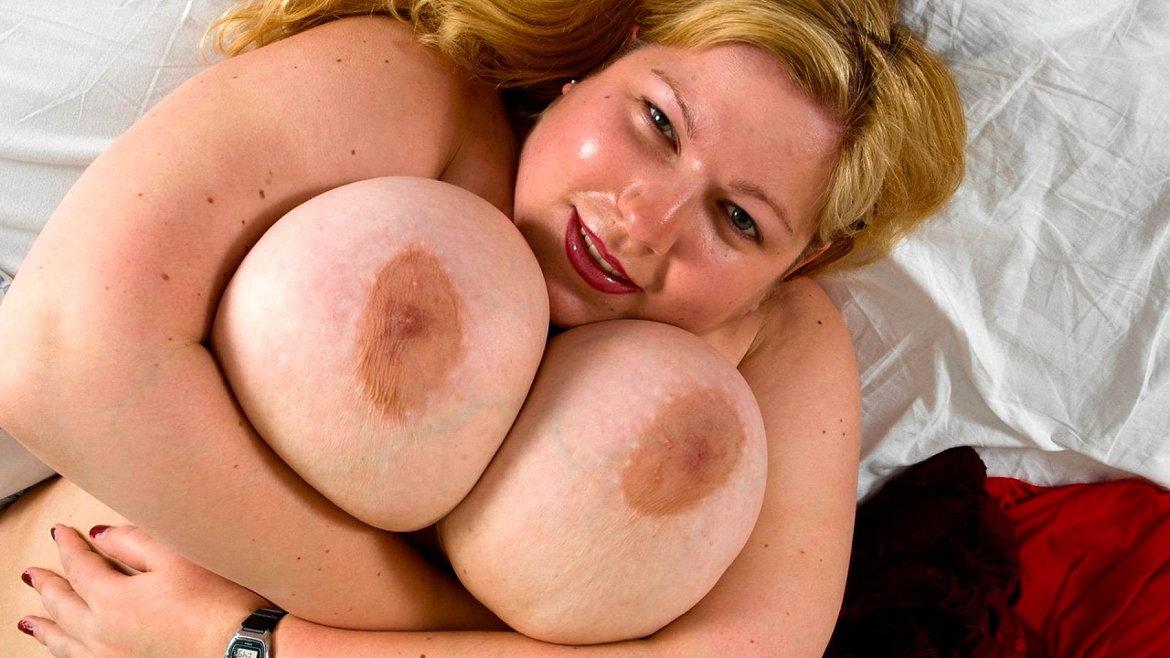 Huge Titted Blonde Touches Up Her Pussy