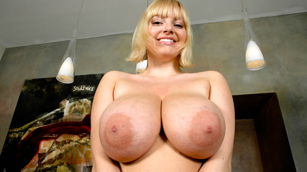 Huge Titted Blonde With Smooth Pussy Strips