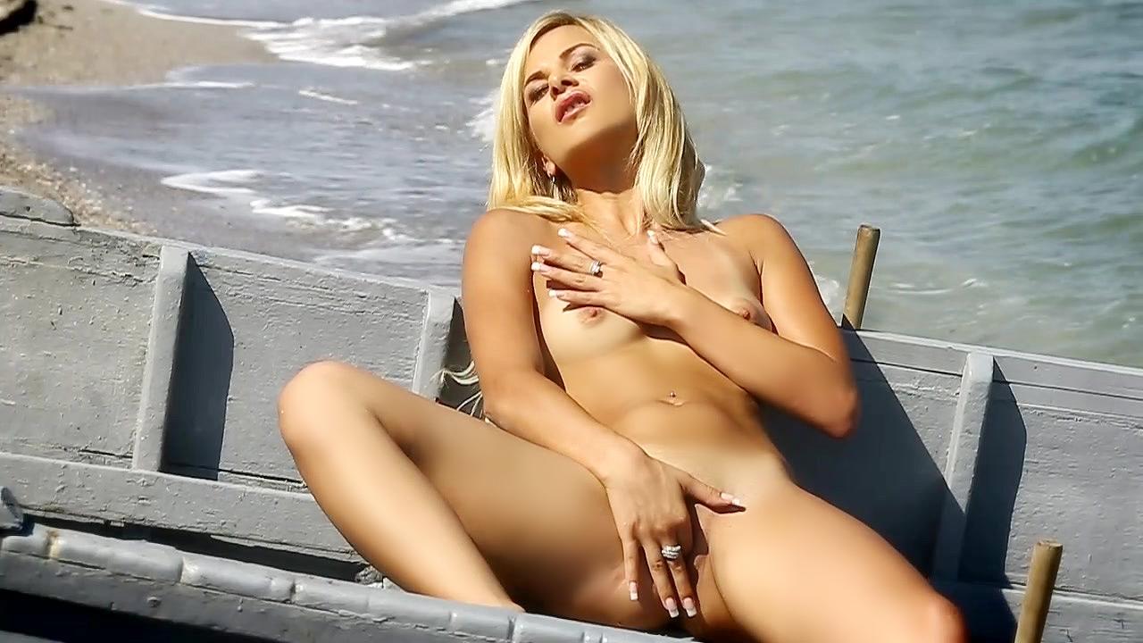 Kelly White Masturbates And Enjoys The Sun At The Waters Edge