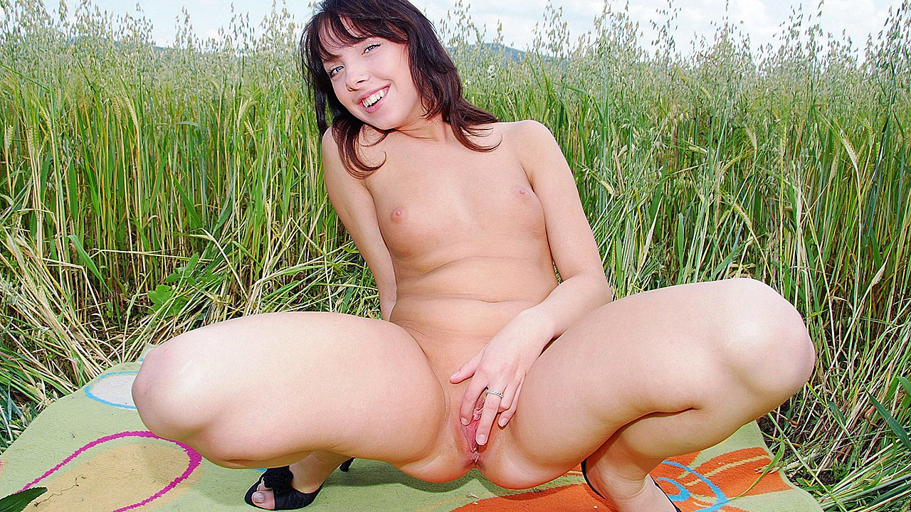 Petite Brunette Finger Bangs Herself In Field